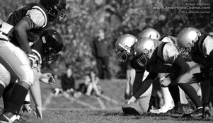 Picture of football players at the link of scrimmage.  Link to more free downloadable pictures and wallpapers.  (c) 2011, FreePhotoCourse.com, all rights reserved.