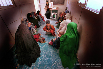 "Picture of women in an Afghanistan camp attending a women's contraception workshop put on by Medicins Du Monde.  © 2003, Matthieu Alexandre; part of FreePhotoCourse.com's ""Photographer Profiles"" series; DO NOT COPY – IP Address recorded - all rights reserved."