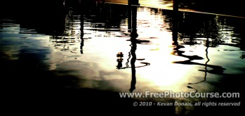Wavy Reflection in Puddle at Side of Road - Fine Art Photography Tips and Lessons - © 2010, Kevan Donais.  Visit www.FreePhotoCourse.com, all rights reserved