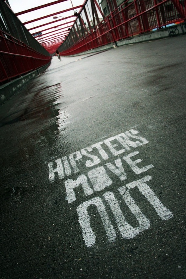 Picture of the Williamsburg Bridge, New York City, grafitti on pavement 'Hipsters Move Out'; part of the popular New York City Photography Exhibit 'NYC Exposed' by FreePhotoCourse.com; photo credit: Stan Baranski, all rights reserved
