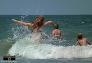 Fun picture of kids jumping in the waves at the beach.© 2011, FreePhotoCourse.com, all rights reserved.  Awesome beach pictures & wallpapers. Download free jpg, jpeg photos.