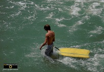 Cool picture of a boy towing his yellow boogie-board into the waves at the beach. © 2011, FreePhotoCourse.com, all rights reserved.  Awesome beach pictures & wallpapers. Download free jpg, jpeg photos.