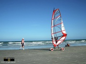 Picture of a beachside wind surfer on wheels. © 2011, FreePhotoCourse.com, all rights reserved.  Awesome beach pictures & wallpapers. Download free jpg, jpeg photos.