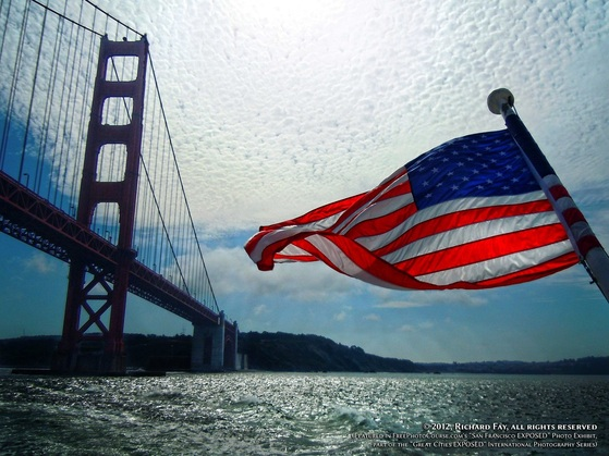 Patriotic picture of San Francisco Bay, with the Golden Gate Bridge and an American flag.  Special Effects picture of the San Francisco skyline in 180 degrees, photographed and created by Steven Shapall. Part of the online artistic photography exhibit,