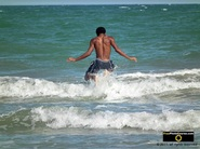 Picture of a boy jumping over waves near the sea shore. © 2011, FreePhotoCourse.com, all rights reserved.  Awesome beach pictures & wallpapers. Download free jpg, jpeg photos.