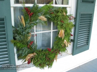 Picture of a Christmas wreath on a window with shutters; enjoy more free pictures and wallpapers from www.FreePhotoCourse.com; ©2010, all rights reserved