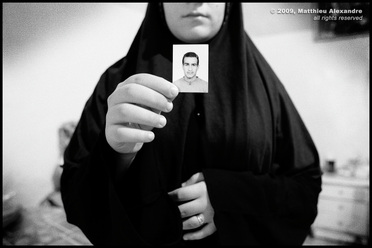 "Picture of a Sunni Iraqi refugee in Lebanon, holding a picture of her missing husband.  © 2009, Matthieu Alexandre; part of FreePhotoCourse.com's ""Photographer Profiles"" series; DO NOT COPY – IP Address recorded - all rights reserved."