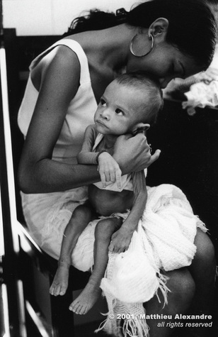 "Picture of a woman holding her malnourished son, waiting for help from a food program in Fortaleza, Brazil.  © 2001, Matthieu Alexandre; part of FreePhotoCourse.com's ""Photographer Profiles"" series; DO NOT COPY – IP Address recorded - all rights reserved."