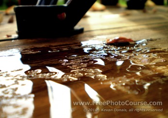 Abstract, Water Droplets, Rain, Reflection - Fine Art Photography Tips and Lessons - © 2010, Kevan Donais.  Visit www.FreePhotoCourse.com, all rights reserved