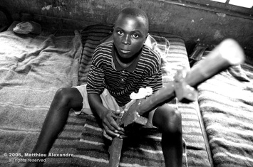 "Picture of a former child soldier in the Congo.  © 2006, Matthieu Alexandre; part of FreePhotoCourse.com's ""Photographer Profiles"" series; DO NOT COPY – IP Address recorded - all rights reserved."