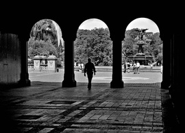Picture if a person walking through an silhouetted archway near the Bathesda Pool, New York City.  Photo Credit: Joseph Constantino.  Selected as the best of entries for July 2011 in the FreePhotoCourse.com Contributor's Gallery.  All rights reserved.