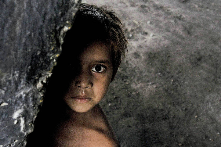 Picture of a young Indian boy that is as beautiful and artistic as it is haunting.  Part of the Photographer Profiles series at FreePhotoCourse.com. © 2010, Soham Gupta, all rights reserved.