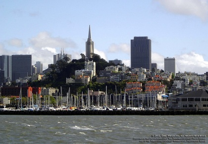 Waterfront picture of San Francisco skyline with sailboats at Pier 39. Special Effects picture of the San Francisco skyline in 180 degrees, photographed and created by Steven Shapall. Part of the online artistic photography exhibit,