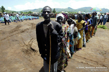 "Picture of Congolese exiles waiting in line for aid distribution.  © 2006, Matthieu Alexandre; part of FreePhotoCourse.com's ""Photographer Profiles"" series; DO NOT COPY – IP Address recorded - all rights reserved."
