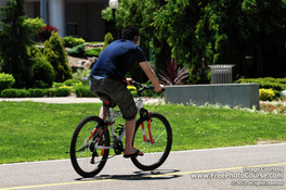 Picture of a cyclist on a bicycle path. Find more free pictures and wallpapers at www.FreePhotoCourse.com.  © 2011, FreePhotoCourse.com; all rights reserved.