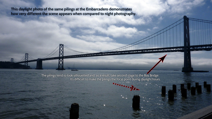 Picture of pilings and the Bay Bridge in the San Francisco Bay at foot of the Embarcadero waterfront.  FreePhotoCourse.com's San Francisco EXPOSED photography exhibit.