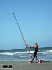 Cool picture of a beachside wind surfer on wheels.© 2011, FreePhotoCourse.com, all rights reserved.  Awesome beach pictures & wallpapers. Download free jpg, jpeg photos.