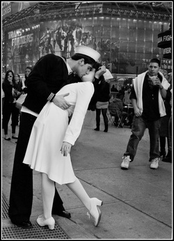 Modern-day version of the famous 1945 LIFE magazine 'The Kiss' photo featuring a sailor kissing a nurse in Times Square on VJ Day in 1945.  This photo was taken by Leon Hertzson in 2010 on the Father Duffy traffic island.  Part of the NYC Exposed photography exhibit by http://FreePhotocourse.com; all rights reserved