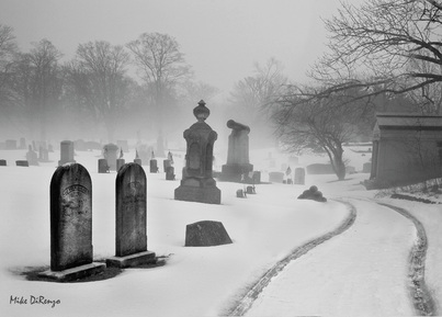 Picture of a winter graveyard scene.  Both haunting and serene.  Beautiful artistic photography, part of FreePhotoCourse.com's 2010-11 Winter Challenge Contributor's Gallery.  © 2011, all rights reserved.  Photo Credit: Mike DiRenzo.
