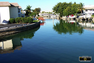 Picture of gorgeous canal in upscale southern gated community. © 2011, FreePhotoCourse.com, all rights reserved.