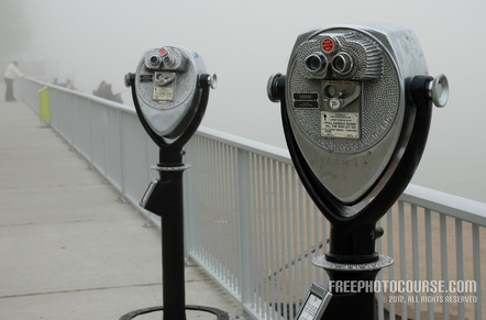 Picture of a pair of coin-operated binoculars on a waterfront vista. Used to illustrate the Rule of Thirds in photographic composition. Part of a tutorial by FreePhotoCourse.com; © 2012, all rights reserved.