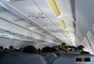 Picture of interior of a commercial airline jet. © 2011, FreePhotoCourse.com, all rights reserved.  Free high-res desktop wallpapers and pictures.