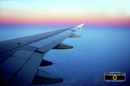 Aircraft Pictures.  Depicts wing of a commercial airline jet over city at cruising altitude.© 2011, FreePhotoCourse.com, all rights reserved.  Free high-res desktop wallpapers and pictures.