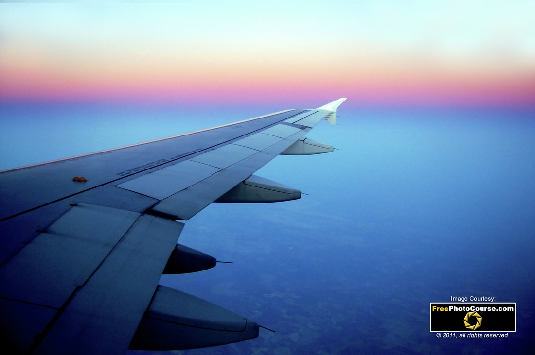 Aircraft Pictures Depicts Wing Of A Commercial Airline Jet Over City At Cruising Altitude