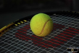 Picture of a tennis ball and racquet.© 2011, FreePhotoCourse.com, all rights reserved.  Free high-res desktop wallpapers and pictures.