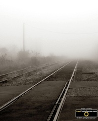 Surreal picture of train tracks disappearing into fog. Find more cool pictures and wallpapers at FreePhotoCourse.com. © 2011, all rights reserved.