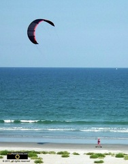 Picture of a kite surfer on the beach.© 2011, FreePhotoCourse.com, all rights reserved.  Awesome beach pictures & wallpapers. Download free jpg, jpeg photos.