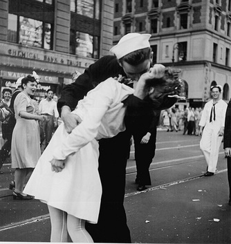 Picture of 'The Kiss' by US Naval  Photojournalist Victor Jorgensen, 1945.  Similar to 'The Kiss' photo by Alfred Eisenstadt that famously appeared in the VJ Day issue of Life Magazine.  Appears in a photography exhibit from www.FreePhotoCourse.com.