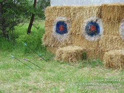 Picture of bales of hay with bulls-eye targets, used for archery / bow and arrow practice.  Free Pictures from http://www.FreePhotoCourse.com. © 2011, FreePhotoCourse.com, all rights reserved
