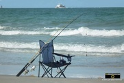 Picture of a folding chair and fishing rod - classic beach scene. © 2011, FreePhotoCourse.com, all rights reserved.  Awesome beach pictures & wallpapers. Download free jpg, jpeg photos.