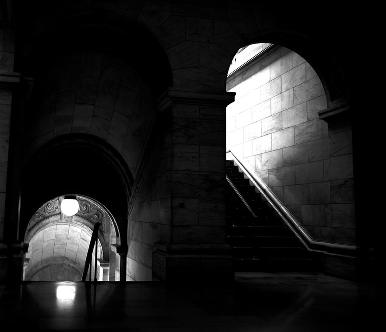 Black & White picture of interior stairwells in New York City Library; part of NYC Exposed online exhibit from www.FreePhotoCourse.com; © 2011, Mathew Spolin