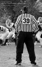 Picture of Referee at Football Game.  Free pictures downloadable at www.FreePhotoCourse.com. © 2011, FreePhotoCourse.com; all rights reserved.