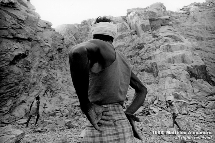 "Picture of stone quarry workers in Tindivinam, India.  © 1998, Matthieu Alexandre; part of FreePhotoCourse.com's ""Photographer Profiles"" series; DO NOT COPY – IP Address recorded - all rights reserved."
