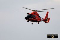 Picture of an orange US Coast Guard Helicopter.© 2011, FreePhotoCourse.com, all rights reserved.  Free high-res desktop wallpapers and pictures.