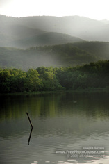 Picture of a serene mountain lake scene.Download free pictures and wallpapers.  © 2011, FreePhotoCourse.com, all rights reserved.