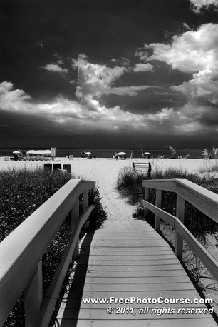 Picture of a beachfront and boardwalk cross-over on Treasure Island.  Photography by Stephen Kristof, © 201; published by www.FreePhotoCourse.com, all rights reserved.