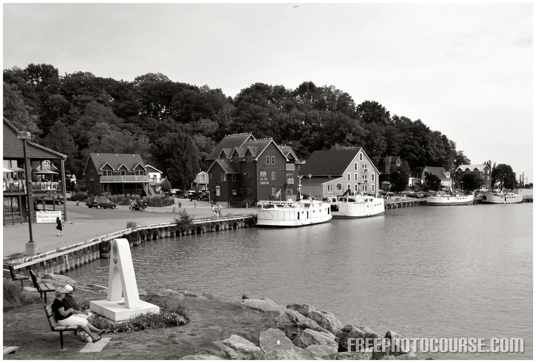 Picture of a fishing village harborfront. Part of an article on photographic composition tips from FreePhotoCourse.com.  (c) 2012, all rights reserved