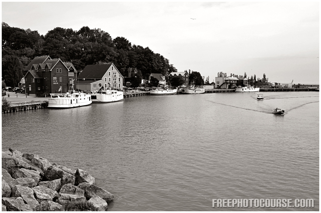 Picture of a fishing village harborfront. Part of an article on photographic composition tips from FreePhotoCourse.com.  (c) 2012, all rights reserved.