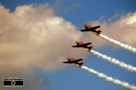 Picture of three Canadian Harvard Airplanes from WW2.  Tight formation air stunt team. ©2010, FreePhotoCourse.com