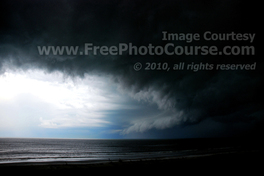Dramatic Picture of Storm over Ocean, © 2010, FreePhotoCourse.com  -  free digital pictures, computer desktop backgrounds, free online photography tips