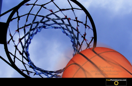 Picture of basketball going through hoop.  Free wallpapers courtesty of www.FreePhotoCourse.com