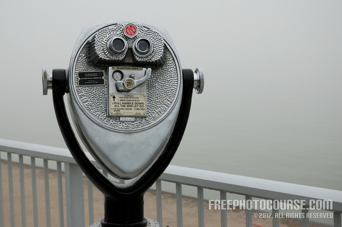 Picture of coin-operated binoculars on a waterfront vista.  Part of a tutorial on the Rule of Thirds in photographic composition. (c) 2012, FreePhotoCourse.com, all rights reserved.