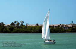 Picture of a sailboat on sub-tropical waters near Captiva Island, Florida.  Find more great all-free pictures at www.FreePhotoCourse.com. © 2011, FreePhotoCourse.com; all rights reserved.