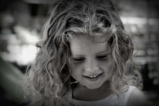 Picture of a young girl smiling. Featured in FreePhotoCourse.com's Monthly Contributor's Photo Gallery. © 2012, Carmel Lalo.