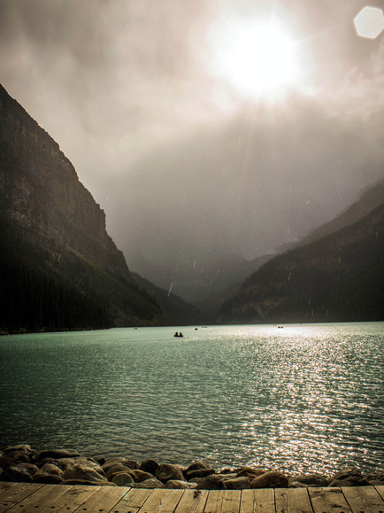 Picture of beautiful rain and sun over Lake Louise, Alberta, Canada.  Selected to be featured in the September, 2012 Contributor's Gallery at FreePhotoCourse.com.  Photo by Leah McInnis, © 2012, all rights reserved