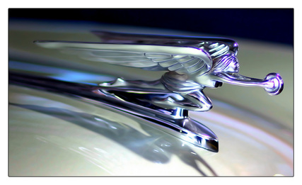 Artitistic picture of a hood ornament.  Featured in the September 2011 Contributor's Photo Gallery at FreePhotoCourse.com.  © 2012, Greg Lueck, all rights reserved
